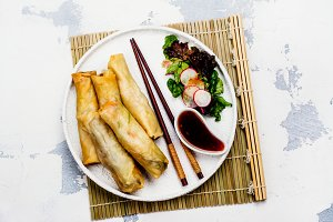 Fried spring rolls with vegetables, duck meat and noodle