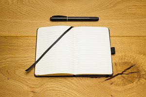 Empty pages notebook marker on desk