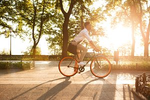 Young african man early morning with bicycle walking