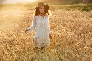 Amazing serious young woman standing in the field