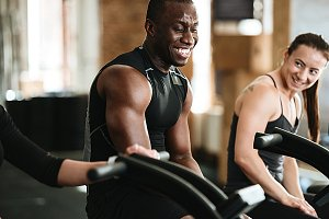 Group of young multiracial people exercising on treadmills