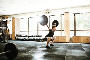 Caucasian sports strong man make sport exercise with barbell.