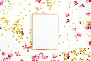 Photo frame and golden confetti