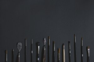 Paint Brushes on black background