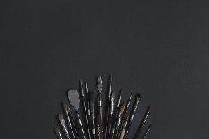 Fanned Paint Brushes on Black BG
