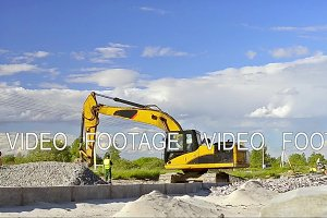 Excavator digging on construction high-speed road