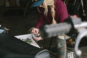 Lady Mechanic working on motorcycle