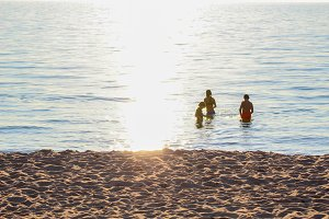 Three Kids in Water at Sunset