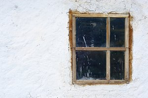 Old window on a white wall