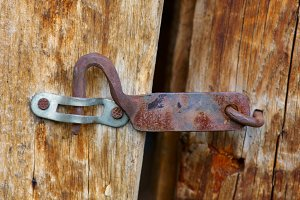 Old rusty latch on a wooden door