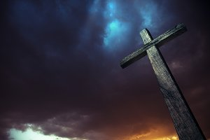 Dramatic sky and a wooden cross