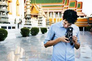 Man Using a Vintage Camera