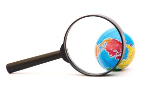 Globe and magnifying glass