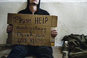 Homeless sitting on a Street
