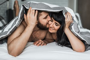 Loving couple under a blanket