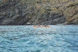 family walking by sea canoe