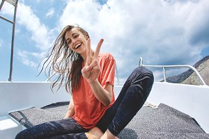 happy young smiling woman in the white boat