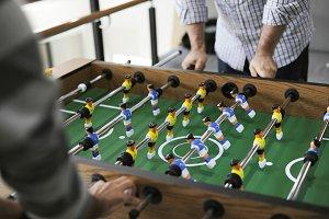 Men playing foosball table
