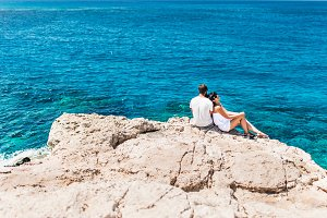 Couple by the sea on a rock