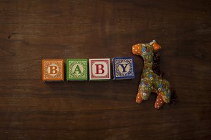 Baby letter blocks with toy giraffe