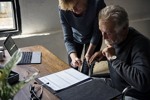 Elderly couple completing a form