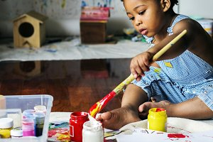 Little boy painting color