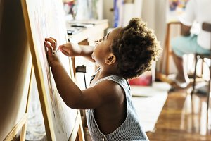 Little boy painting color