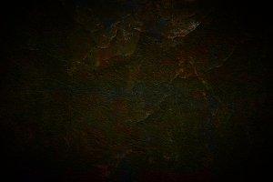 Dark concrete background with cracks