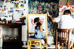 Father and son painting together