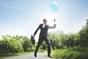 Businessman holding balloon