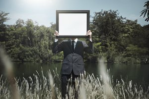 Businessman holding a picture frame