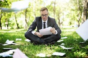 Businessman looking paperworks