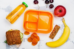 Lunch box, sandwich and fruits
