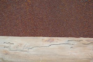 Rusted iron metal and old wood - background for design