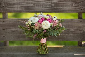 Beautiful wedding bouquet of peonies