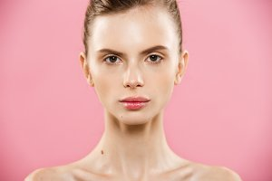 Skin Care Concept - Charming young caucasian woman with perfect makeup photo composition of brunette girl. Isolated on pink background with Copy Space.