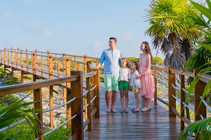 Young family on summer tropical vacation. Family travel concept