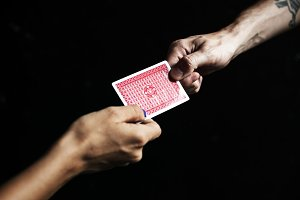 Person handing over a game card