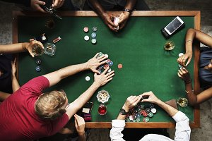 Diverse group playing poker