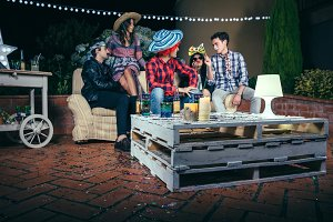 Pallets table with beverages and confetti in party