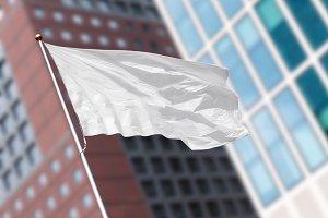 White blank flag against skyscraper
