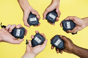 Hands holding stopwatch