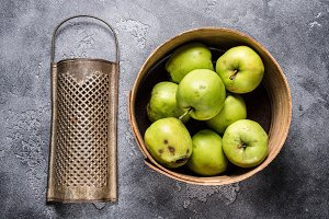 Green apples in vintage wooden bowl