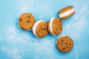 Vanilla ice cream sandwiches on blue background