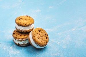 Vanilla ice cream sandwiches on blue background
