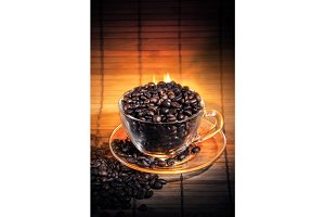Steaming cup of coffee on fire