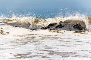 Foamy waves on the beach