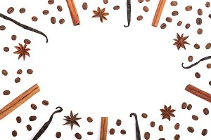 Frame of vanilla sticks, cinnamon, coffee beans and star anise isolated on white with copy space for your text. Top view