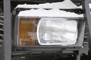 Headlight of a truck on the frozen winter ourdoor - cold outdoor