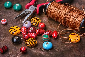 Colorful beads on wooden table